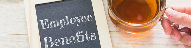 Concept Employee Benefits message on wood boards. Macaroons and